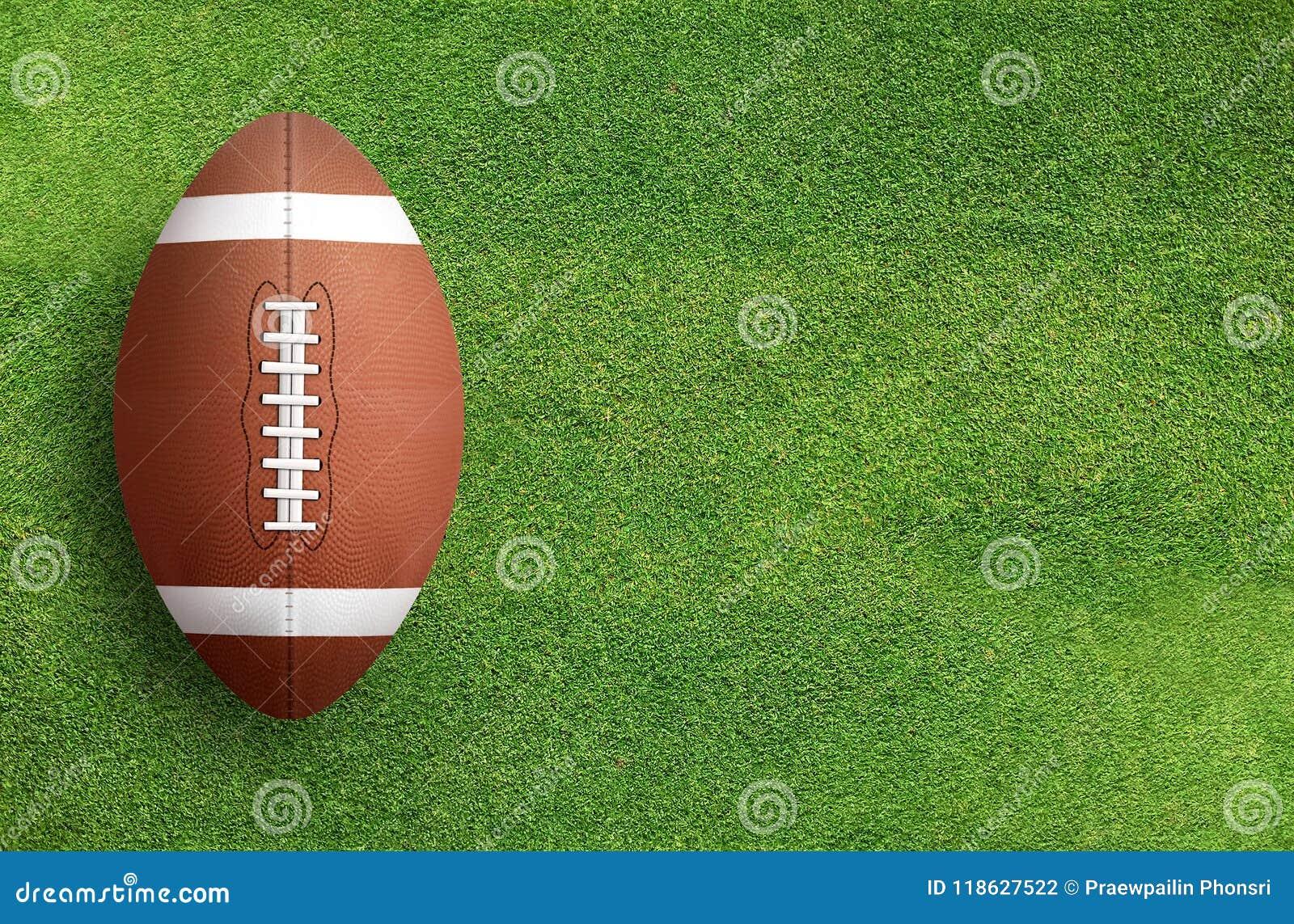 American football ball on grass field background.