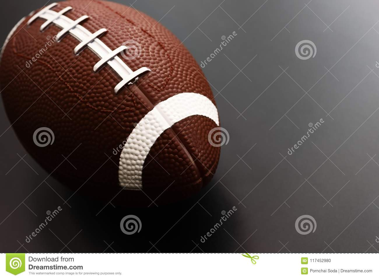 American football on black background. Sport object concept