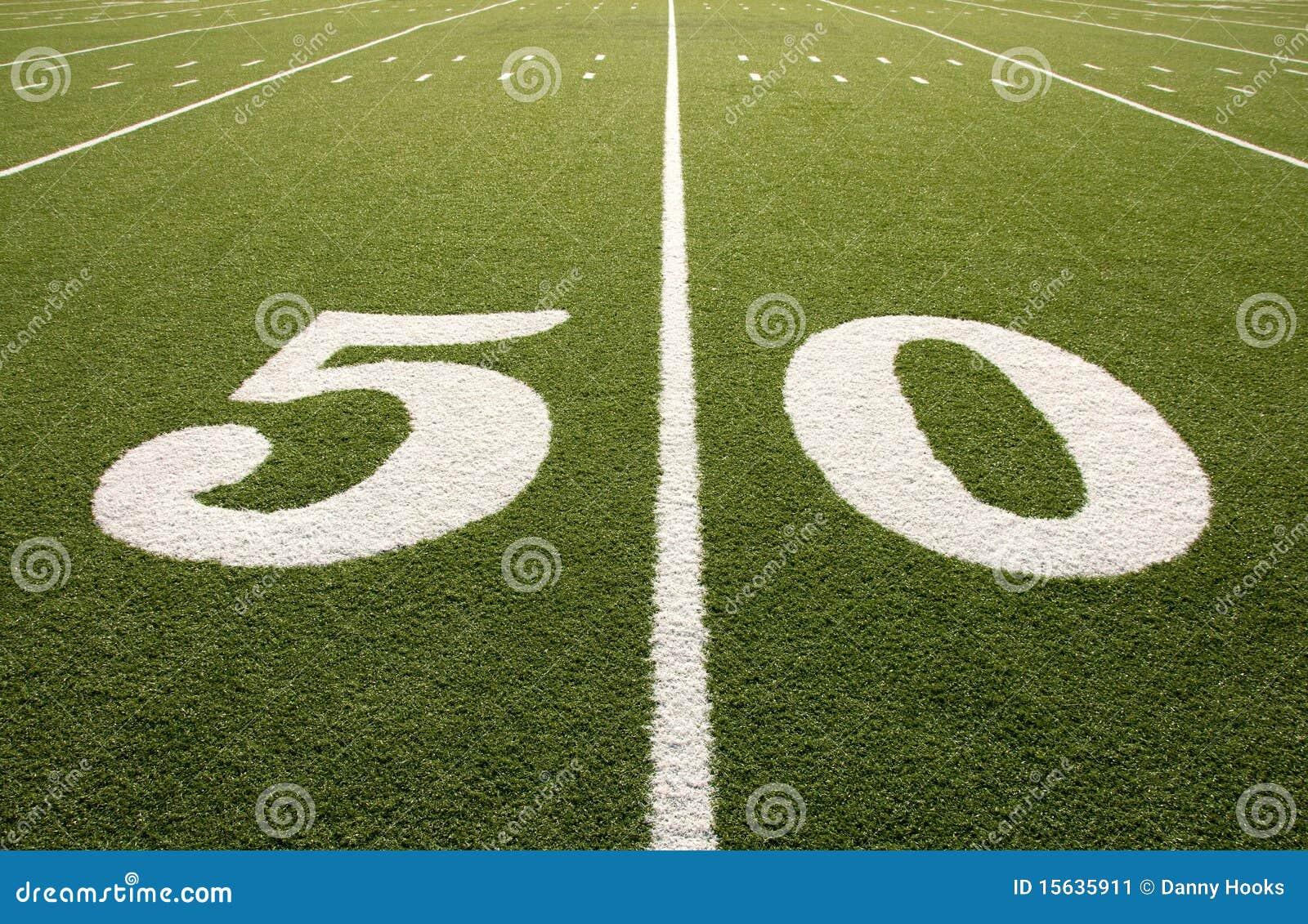 american football field 50 yard line closeup stock image