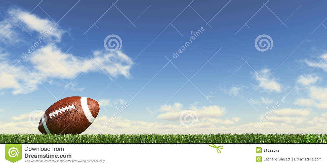 american football  on the grass  with fluffy clouds at the background  stock photography