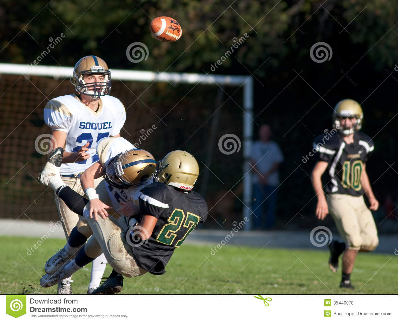 American Football Player Gets Tackled During A Game