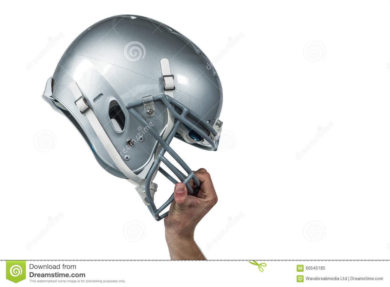 American football player handing his sliver helmet