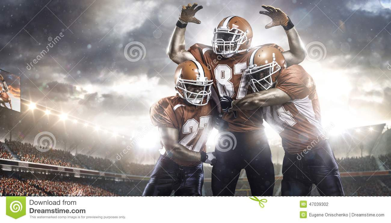 American football players in action on stadium