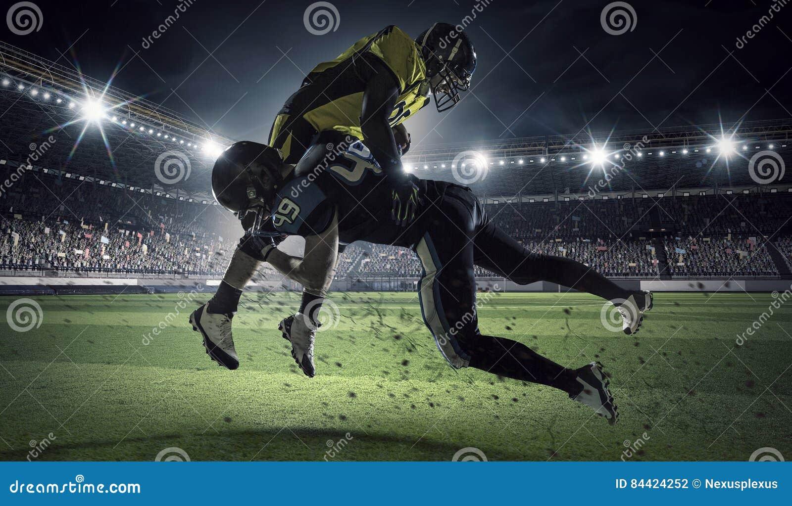 American football players at arena . Mixed media