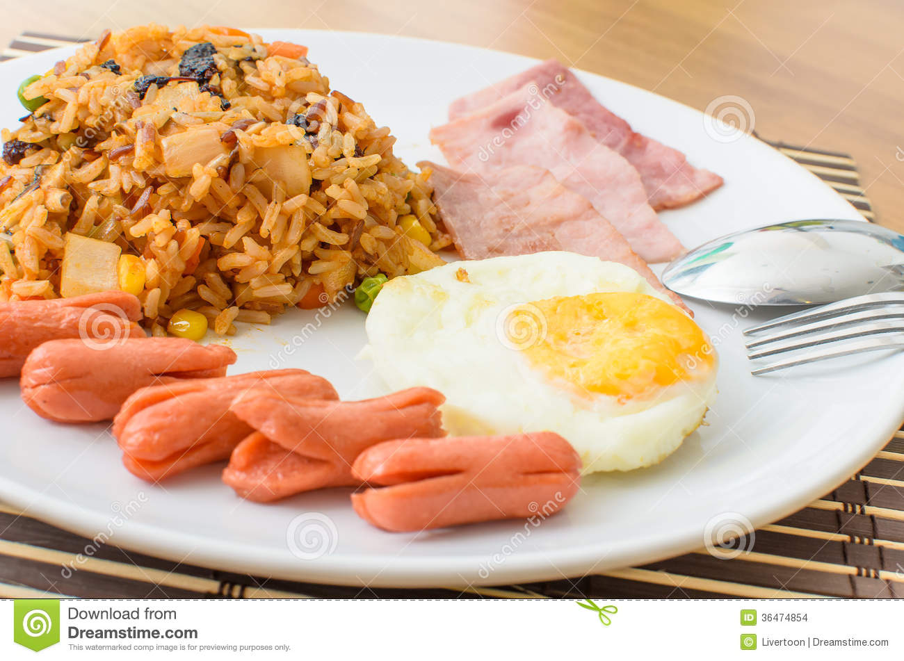 American Fried Rice With Pork Sausage, Bacon And Fried Egg Stock ...