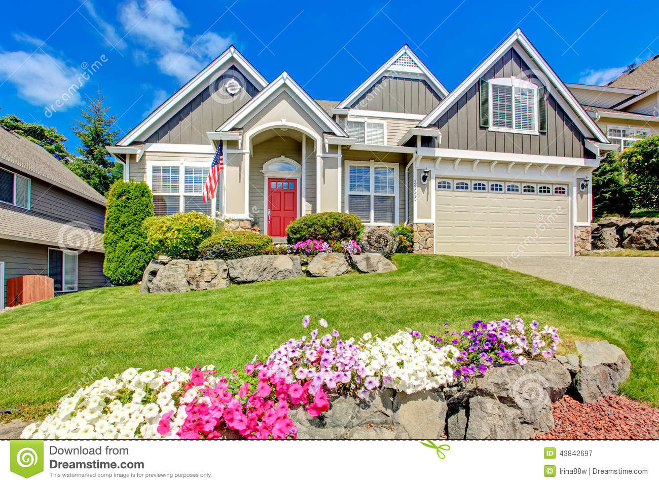 American house with beautiful landscape and vivid flowers for Beautiful front of houses