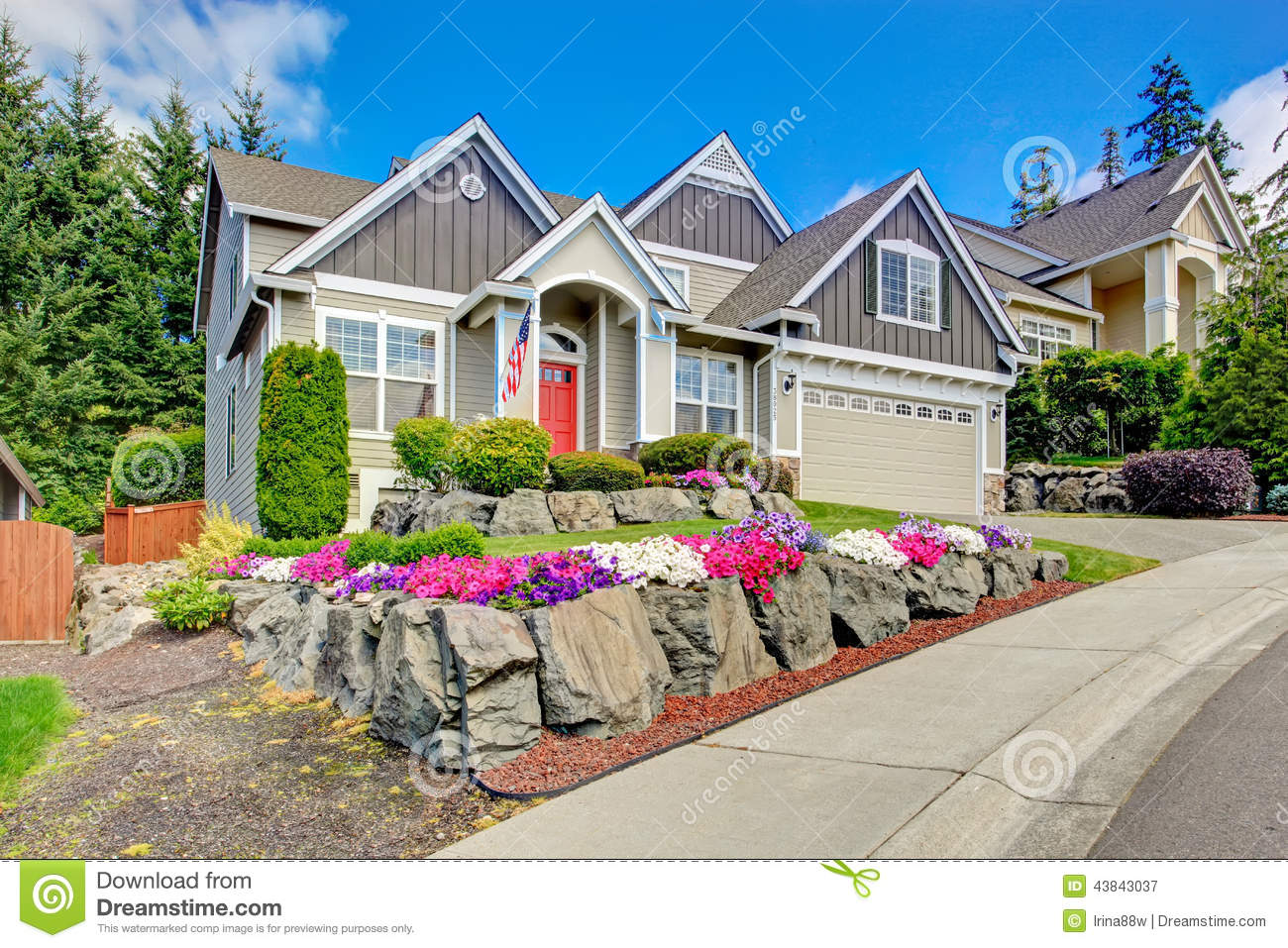 American House With Beautiful Landscape And Vivid Flowers ...