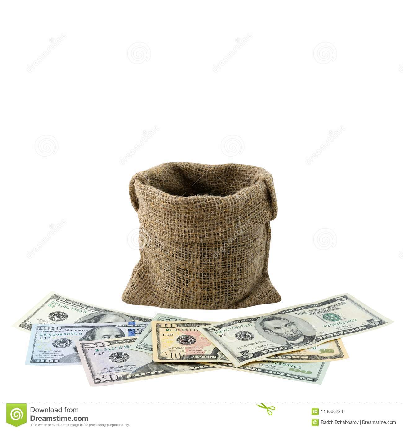 American money 5,10, 20, 50, new 100 dollar bill and empty bag isolated on white background clipping path. Pile US banknote