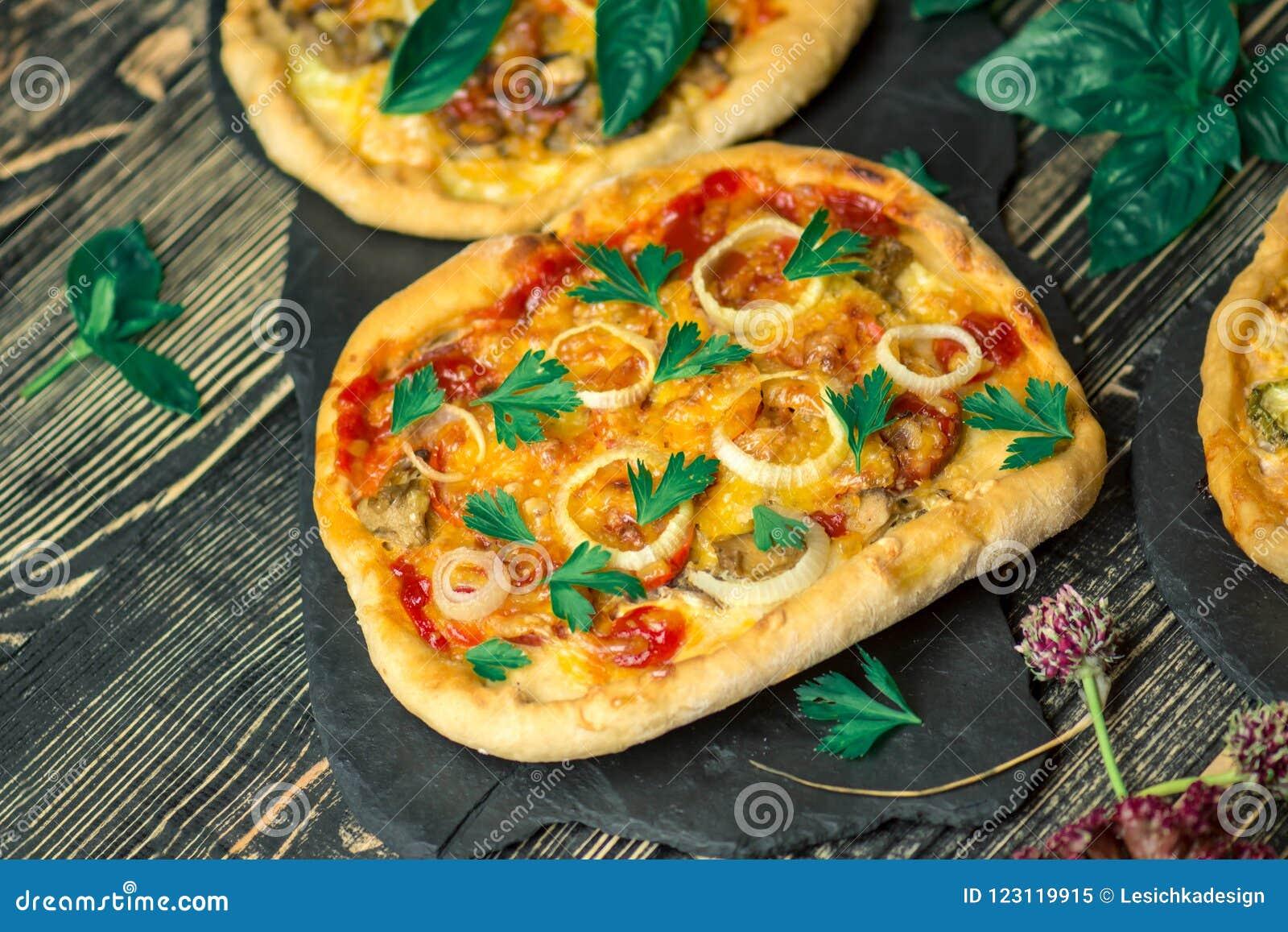 American pizza with mozzarella, tomato, pepperoni on dark wooden table.