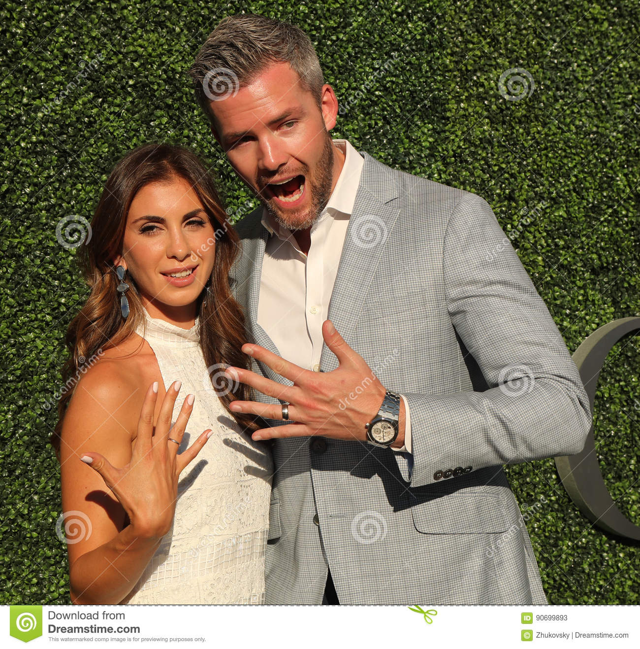 American Real Estate Salesperson And Reality Television Star Ryan Serhant R And Emilia Bechrakis Attend US