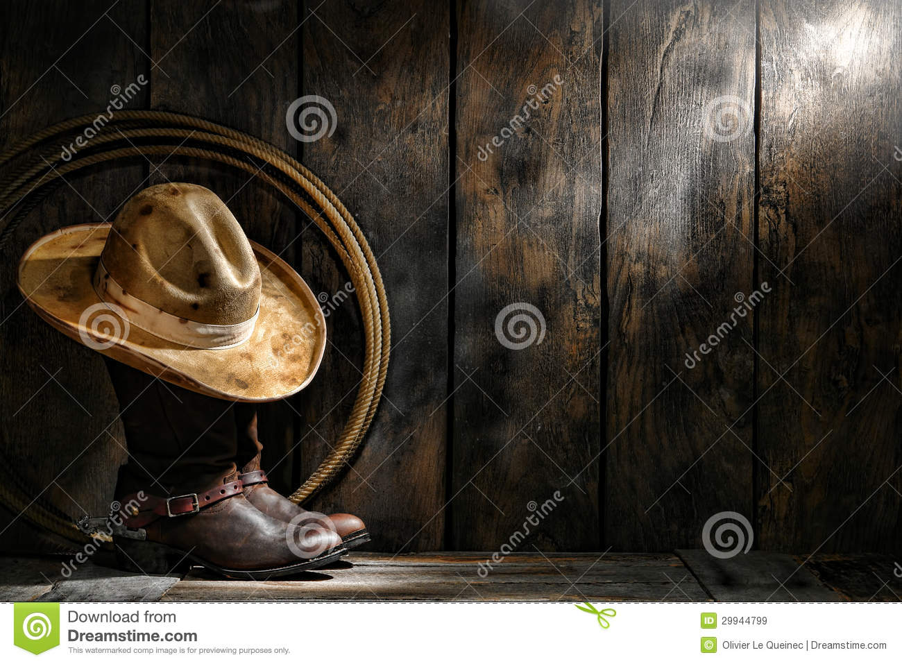 733f4e73633 American West rodeo cowboy dirty used felt hat atop worn leather working  rancher roper boots with old spurs and lasso lariat in an antique ranch  weathered ...