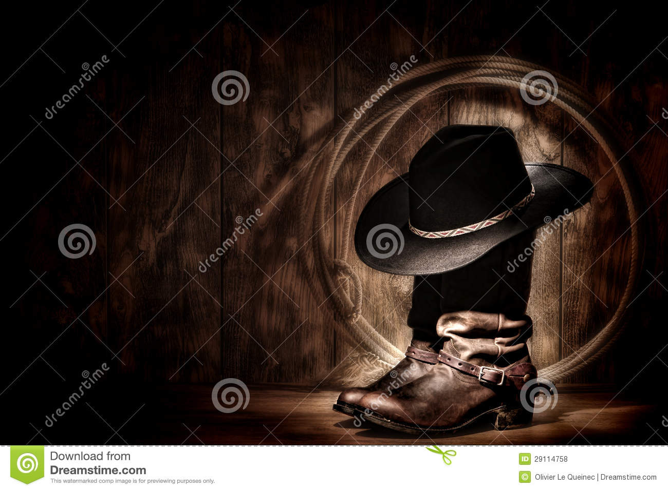 95dc8835545 American West rodeo cowboy traditional black felt hat resting atop worn  leather working rancher roper boots and lasso lariat in a vintage ranch  wood barn ...