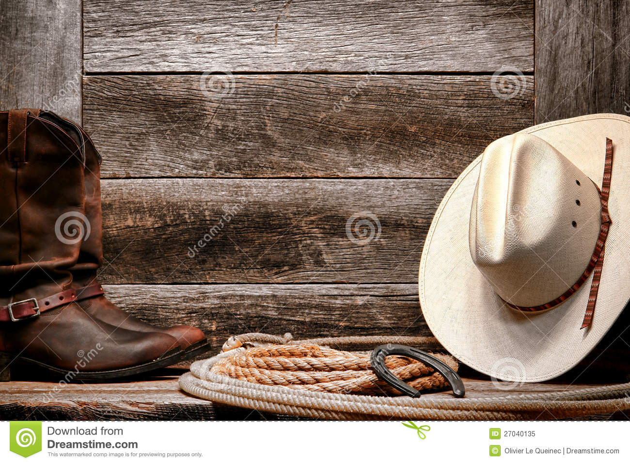American West rodeo traditional white straw cowboy hat with authentic  Western lariat lasso and roper leather boots on distressed barn wood  background d599bf21819a