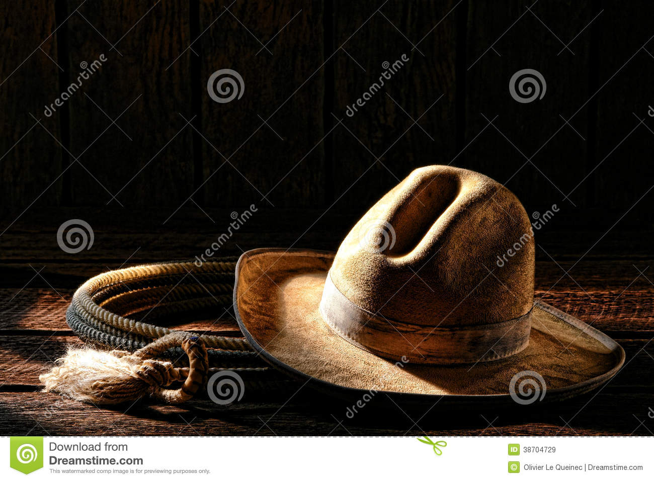 735c3dd83a0 American West rodeo cowboy worn and dirty white felt hat with authentic  roping lariat lasso old weathered wood planks in an old western ranch  wooden barn in ...