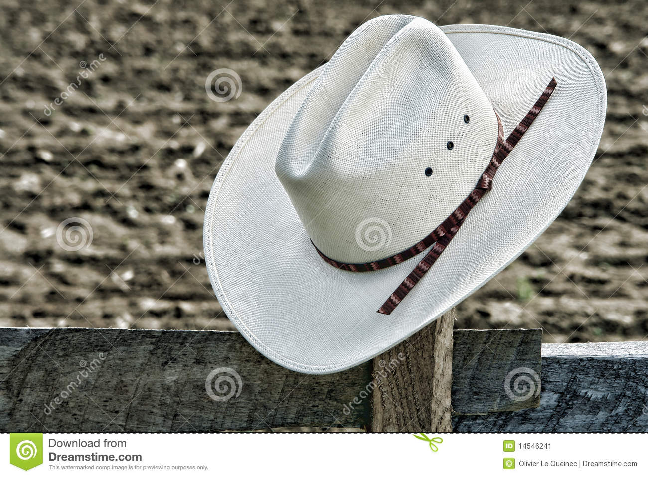 American West Rodeo Cowboy Hat On Ranch Fence Post Stock