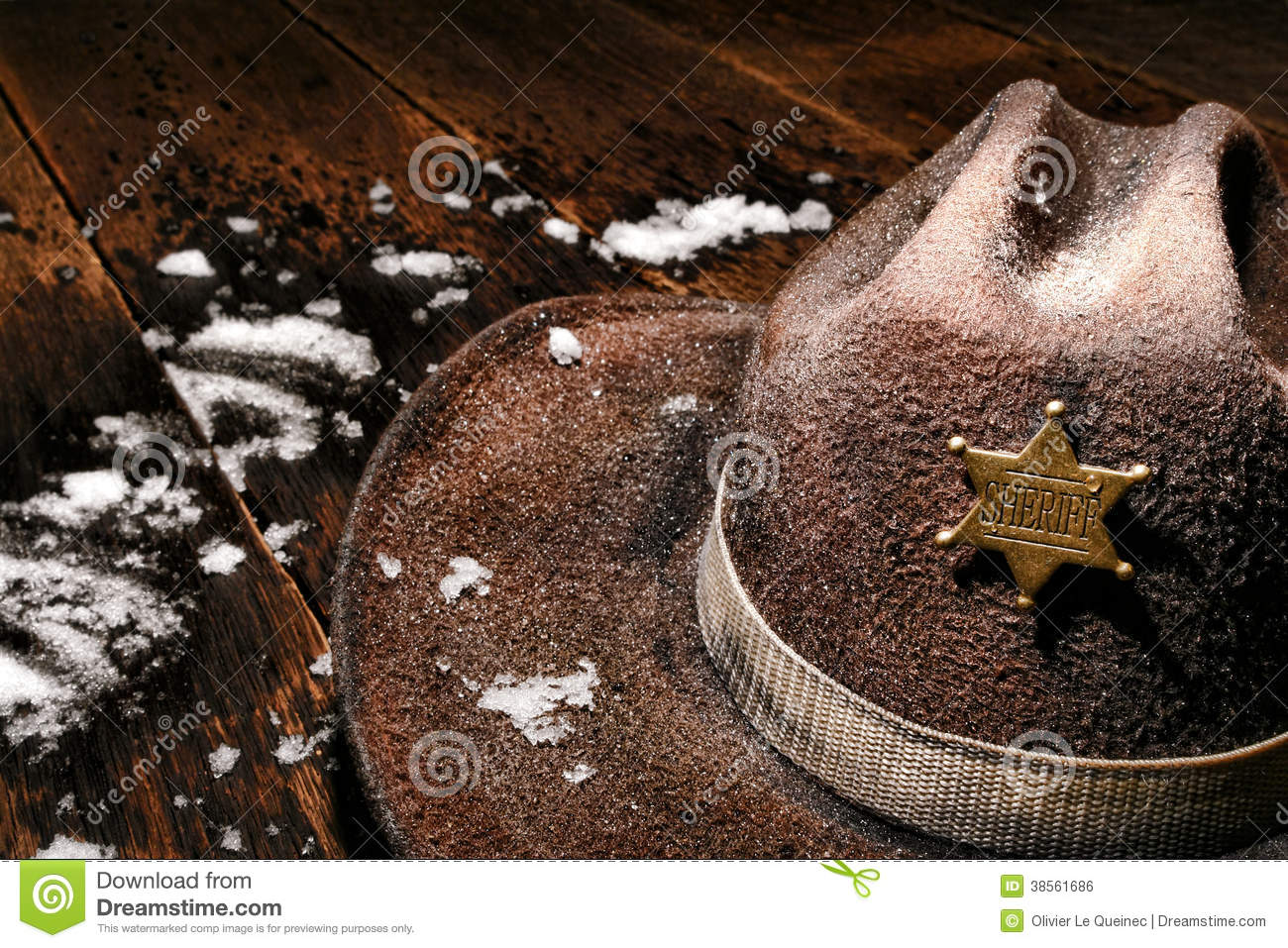 american west sheriff badge on hat and winter snow royalty free