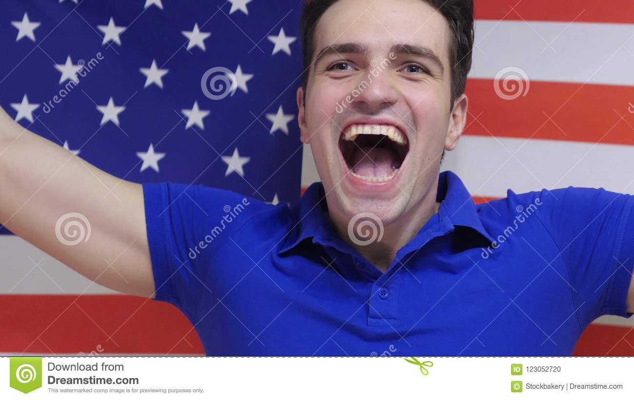 American Young Man Celebrates holding the Flag of USA in Slow Motion