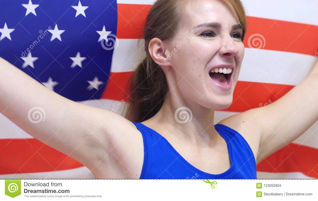 American Young Woman Celebrates holding the Flag of USA in Slow Motion