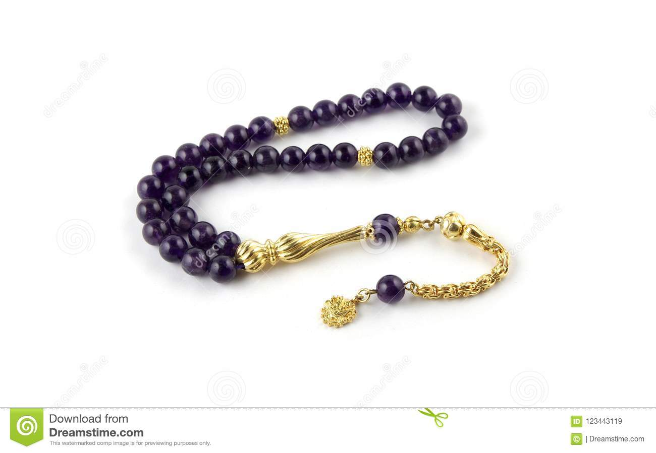 Amethyst prayer beads with gold tassel isolated on white