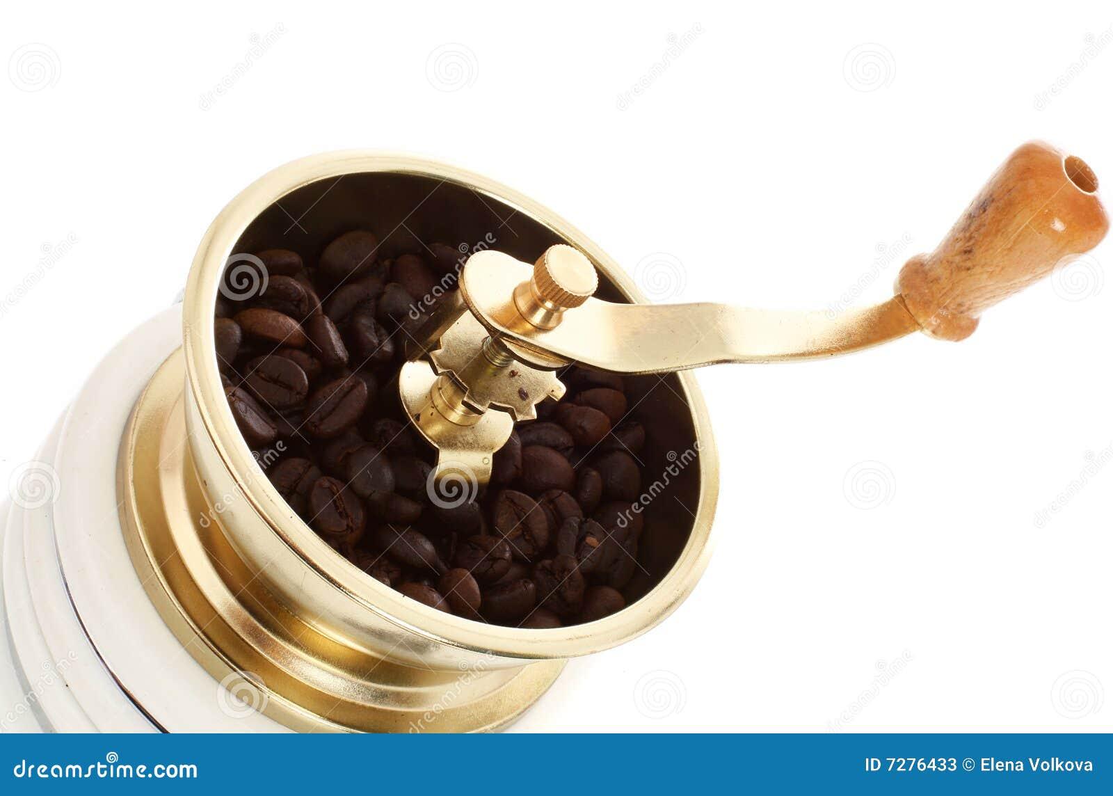 Amoladora de café con los granos de café