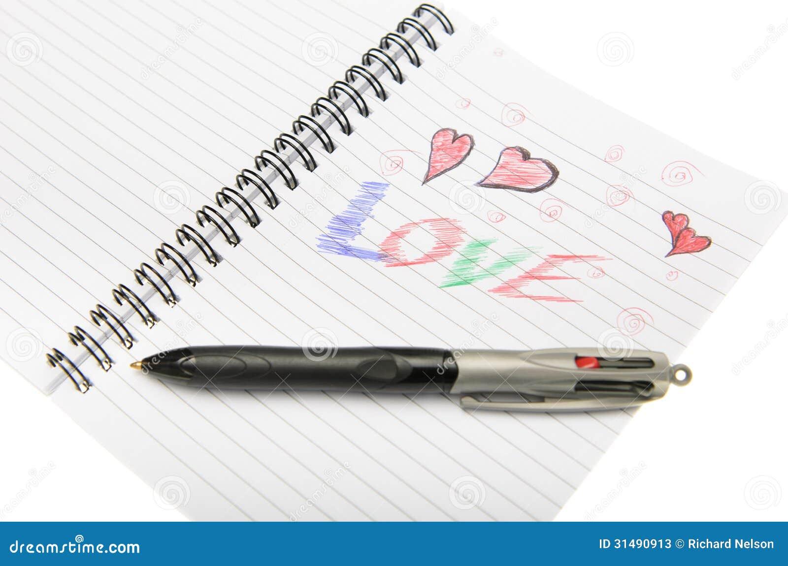 Te Amo Escrito En Pluma En La Arena Imagen De Archivo: Amor Escrito En Cuaderno Con Una Pluma. Fotos De Archivo