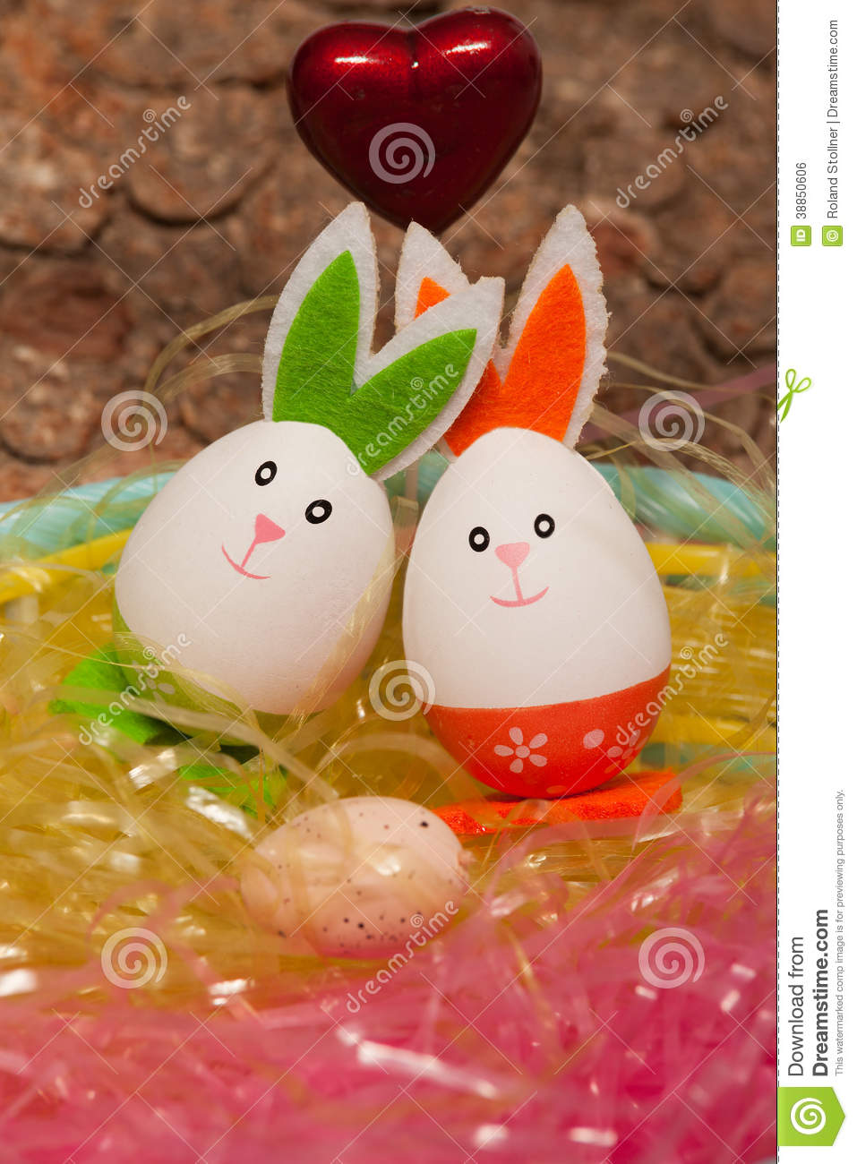 Amorous Couple With A Baby Easter Egg In Easter Stock