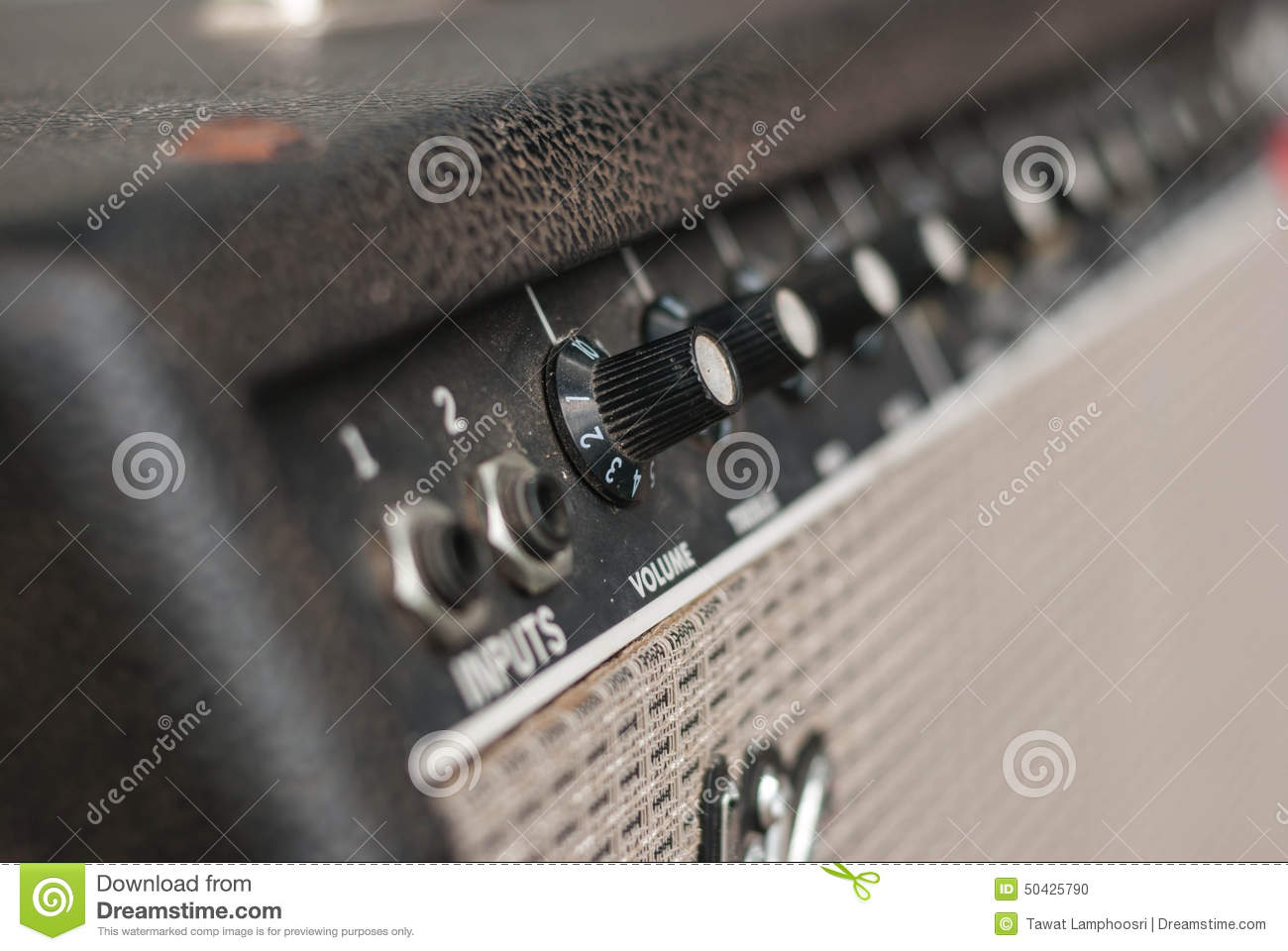 Knobs on a guitar amplifier.