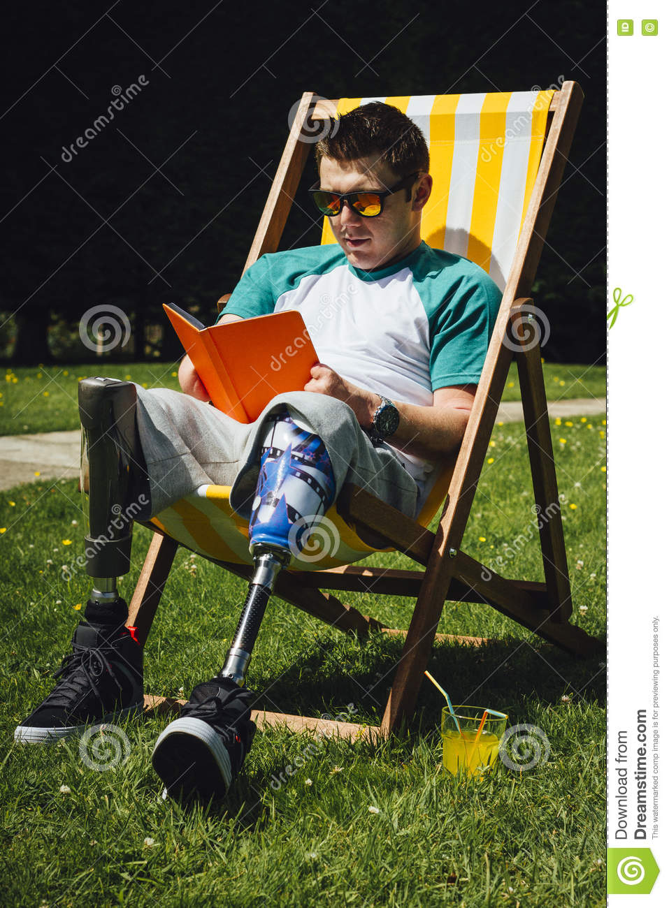 Amputee Reading In The Garden Stock Photo Image 75328380