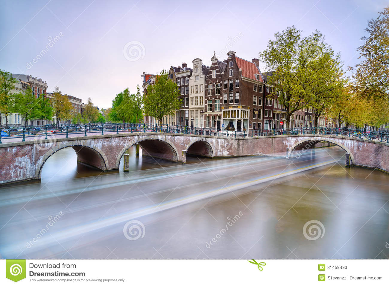 Amsterdam. Bridge And Water Canal. Boat Light Trail On Sunset. Holland Or Netherlands. Stock ...