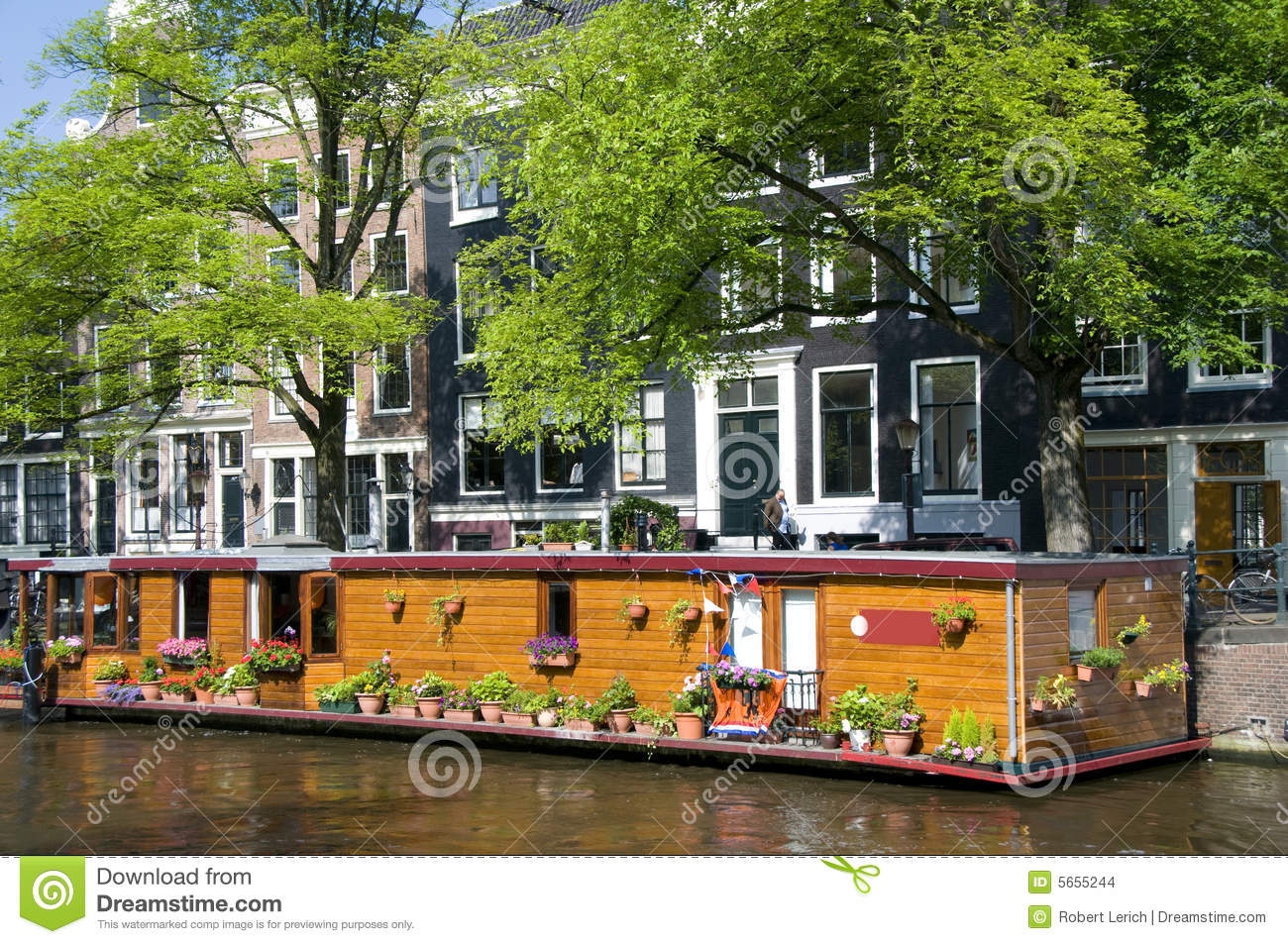 Amsterdam holland canal house boat with flowers stock for Houseboat amsterdam