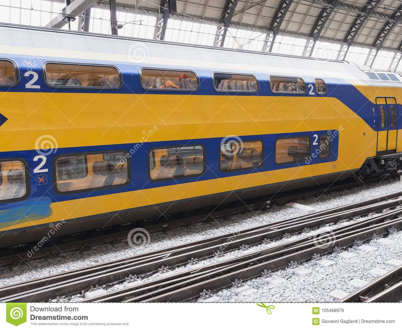 AMSTERDAM - MARCH 2013: Train in main station. Amsterdam Centraal is a famou tourist destination