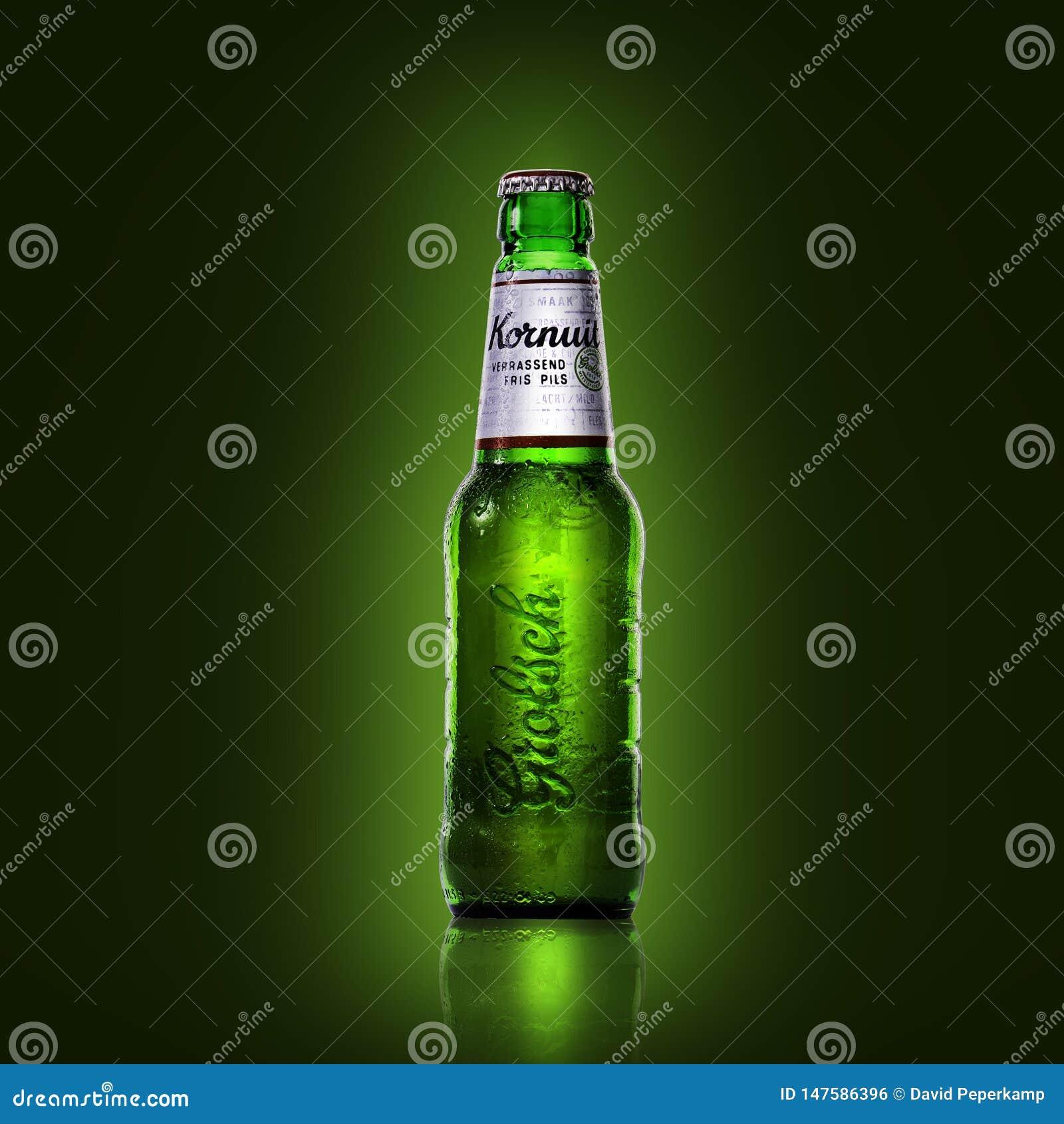 Grolsch Beer bottle on a green background,