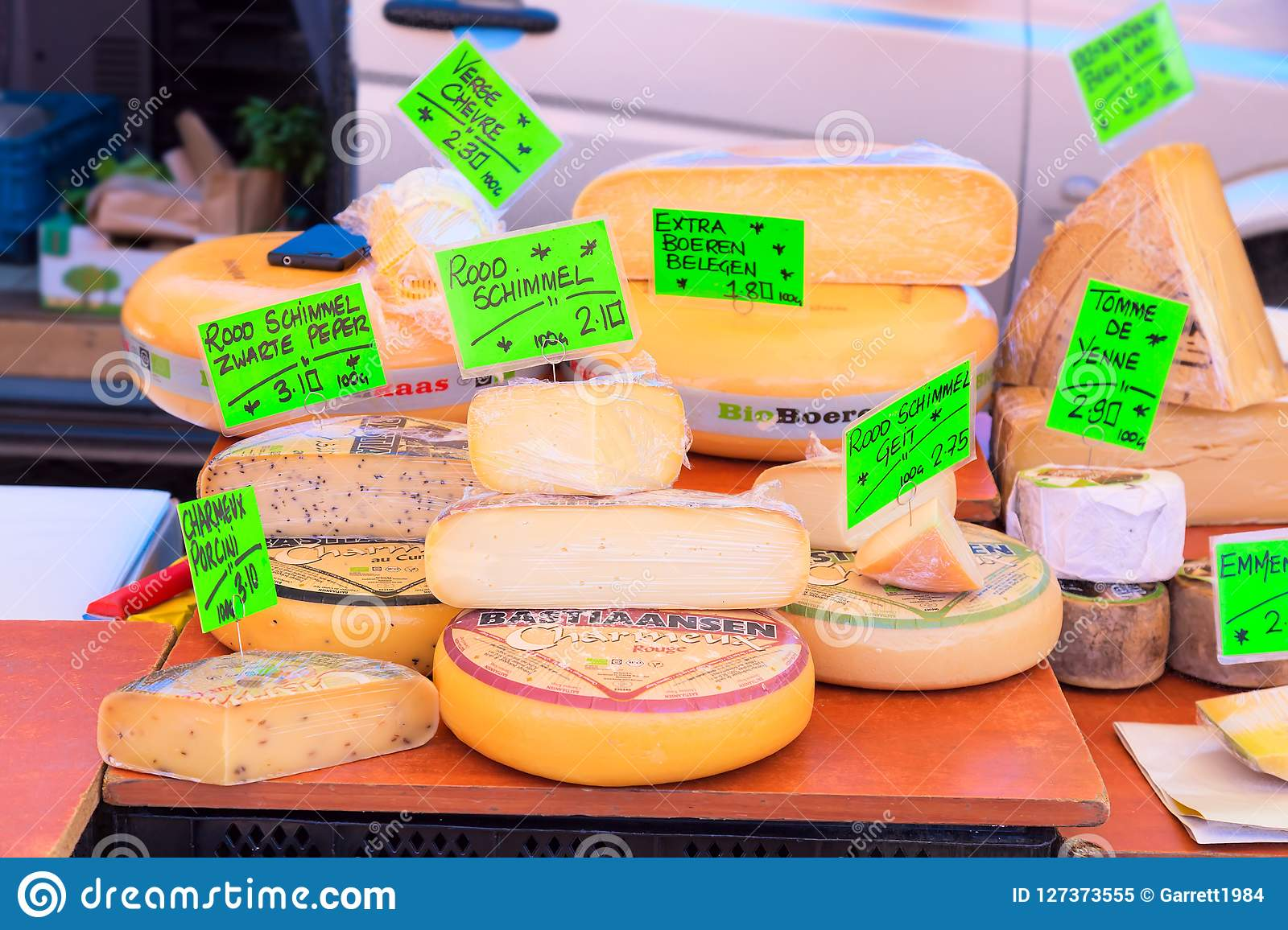 Amsterdam, Netherlands - May, 2018: Street market stall with cheese on the market in Amsterdam, Netherlands.