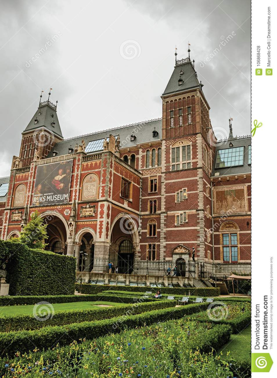 Garden And Rijksmuseum National Museum Facade With People And Cloudy ...