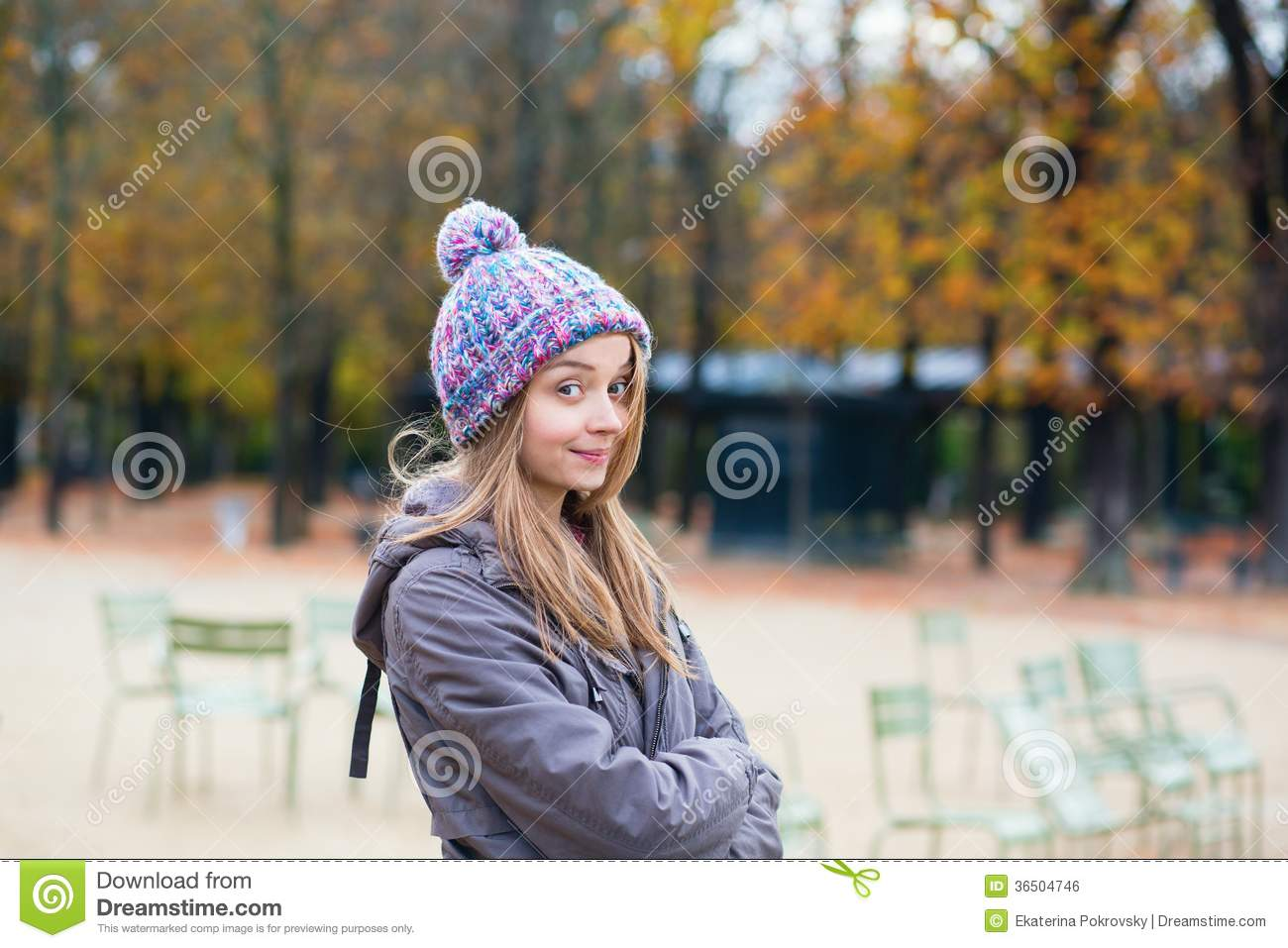 Amused girl in the Gardens of Luxembourg in Paris