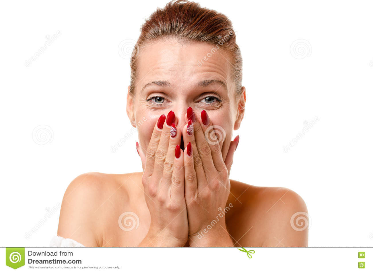Amused young woman trying to stifle her laughter