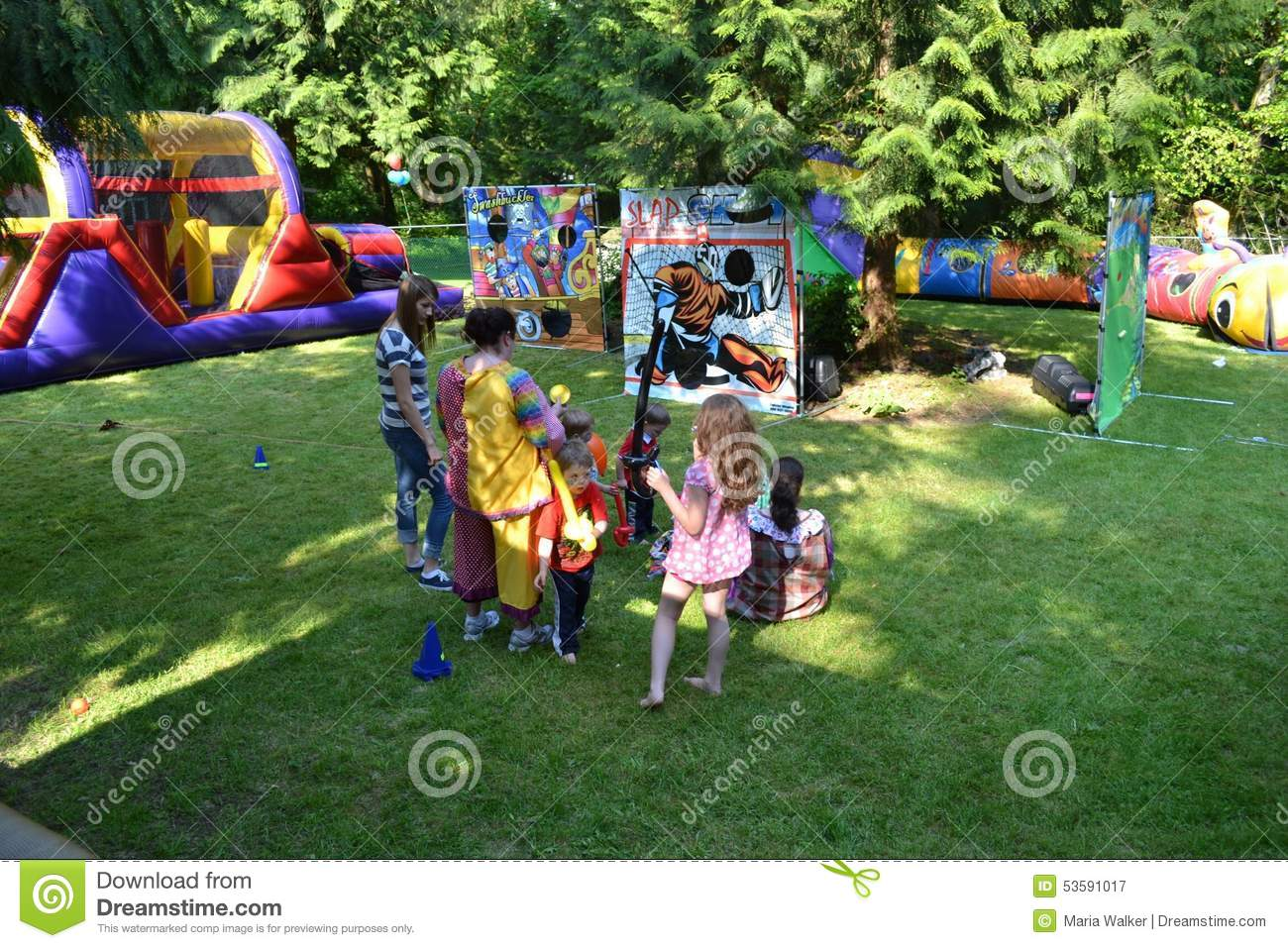 Birthday Party Games And Gather Around For Cotton Candy Popcorn Hotdogs Family Enjoys A Backyard Carnival Walking Past The Snail With