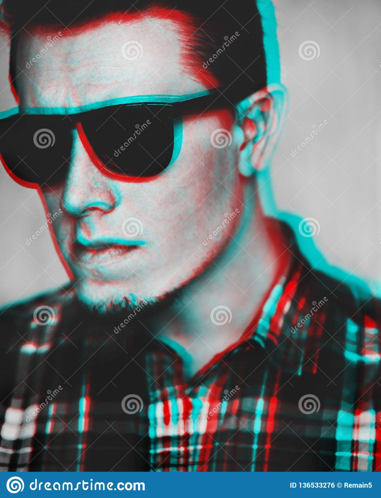 Anaglyph effect of young man in sunglasses.
