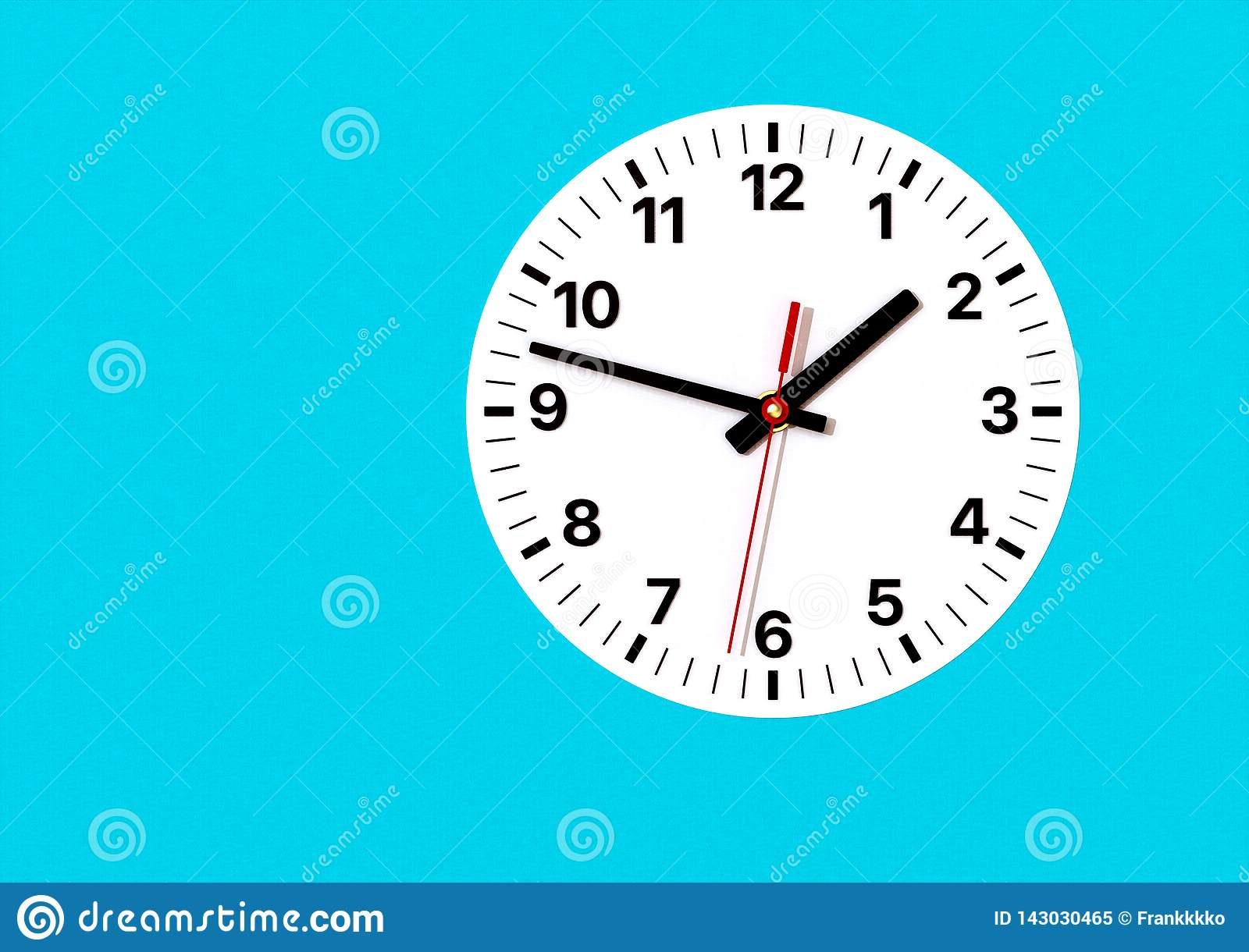 Analog clock on wall, with hour, minute and second hands