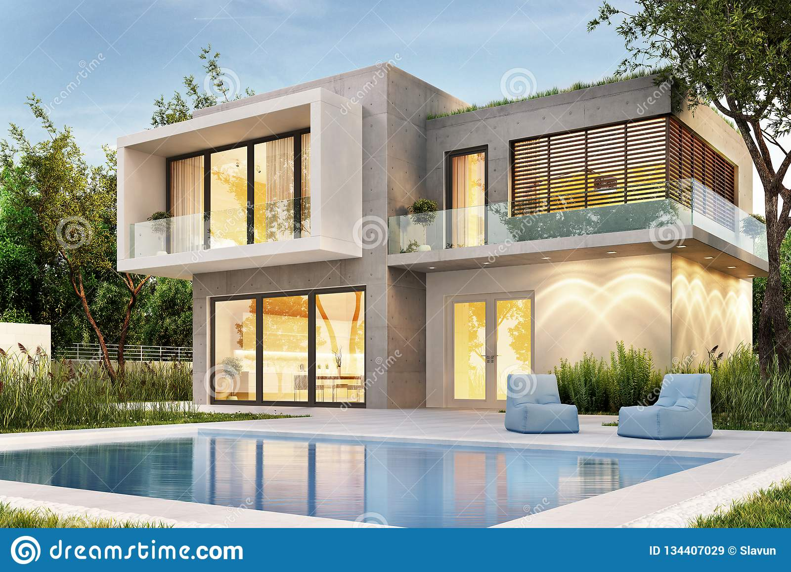 Anche vista di una casa moderna con illuminazione e una piscina