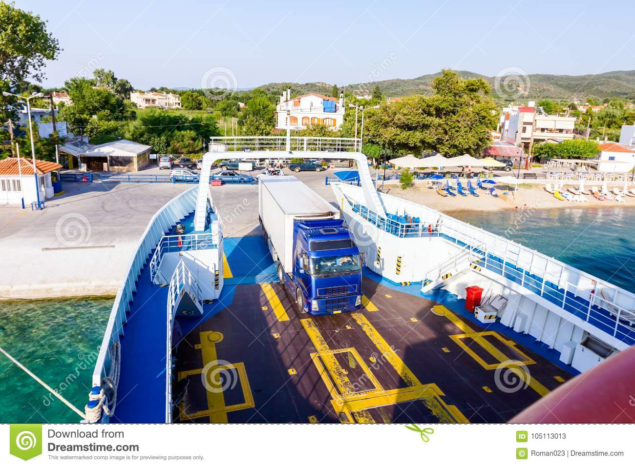 Lorry trucks are entering ferryboat, boarding cars
