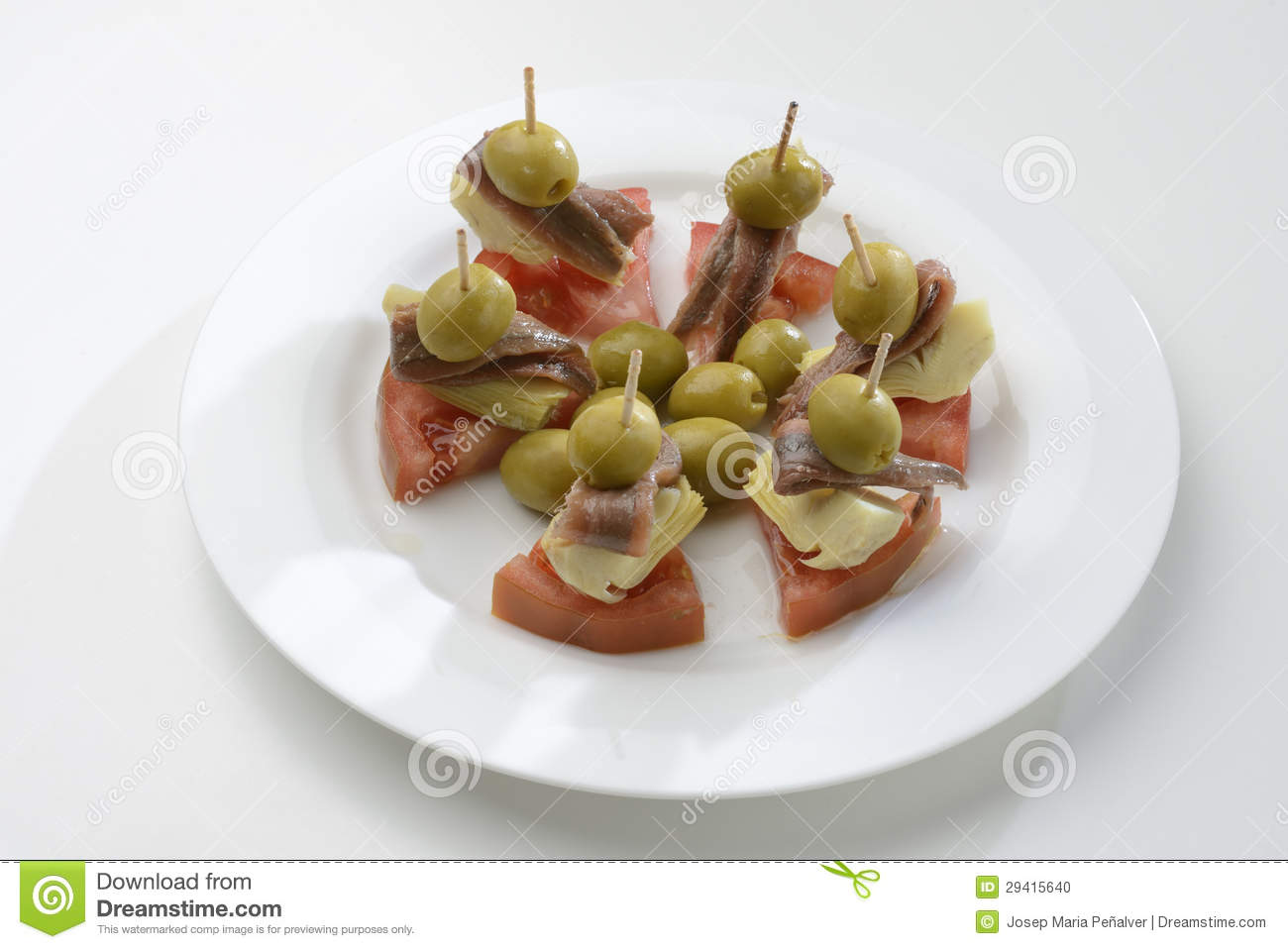 Anchovies, Stuffed Olives, Artichokes And Tomatoes Stock Photo - Image ...