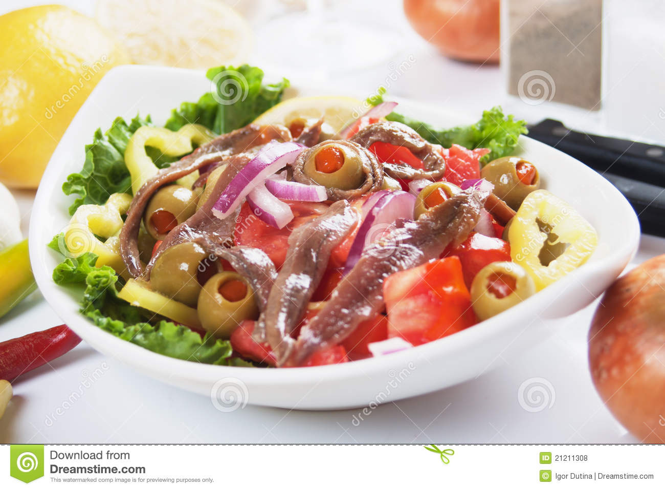 Anchovy salad with olives, tomato, onion and pepper.