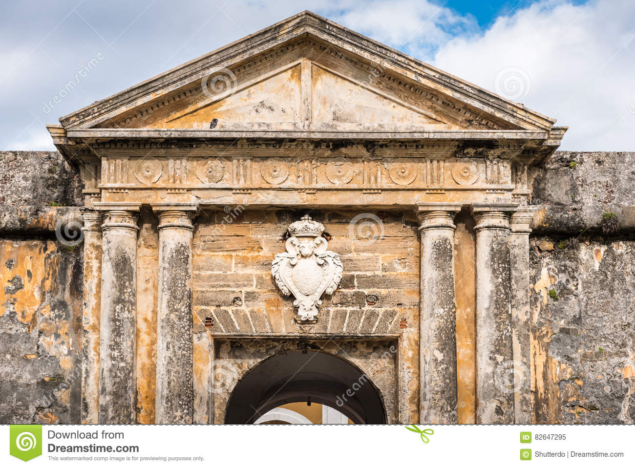 Ancient archway and medallion over door with stone columns