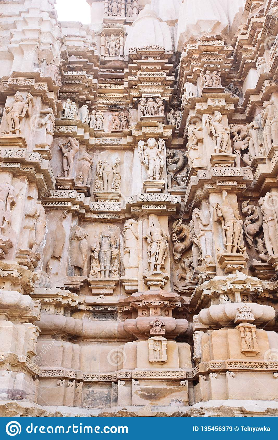 Ancient bas-relief at famous erotic temple in Khajuraho, India