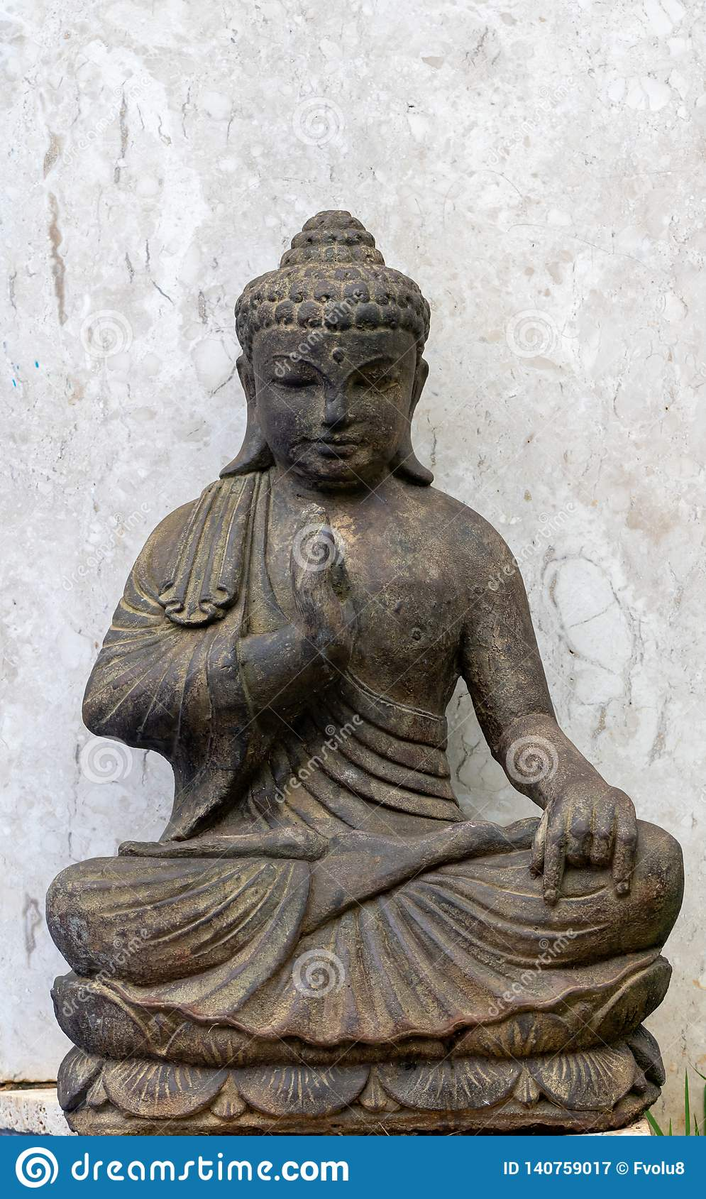 Ancient buddha stone statue with white background