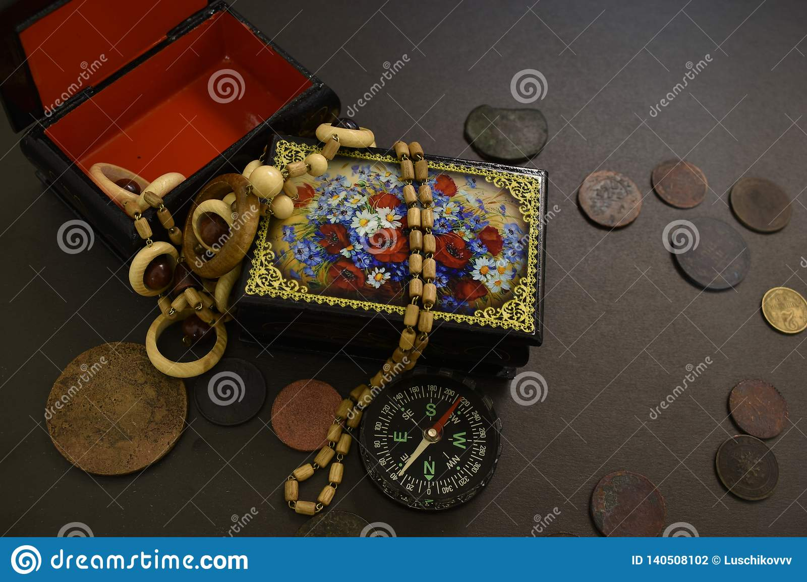 Ancient coins, casket, beads and compass.