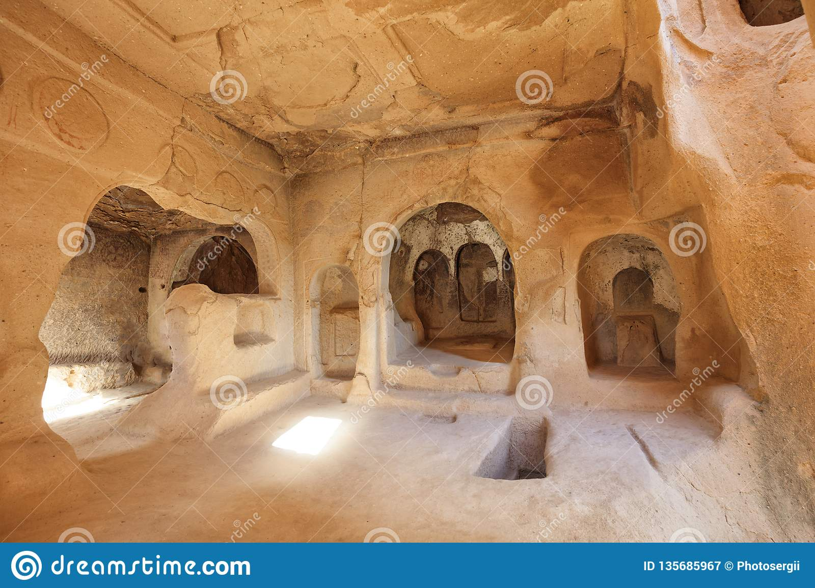 View of the ruins of the premises of the ancient church in the old cave sandstones in the valleys of Cappadocia