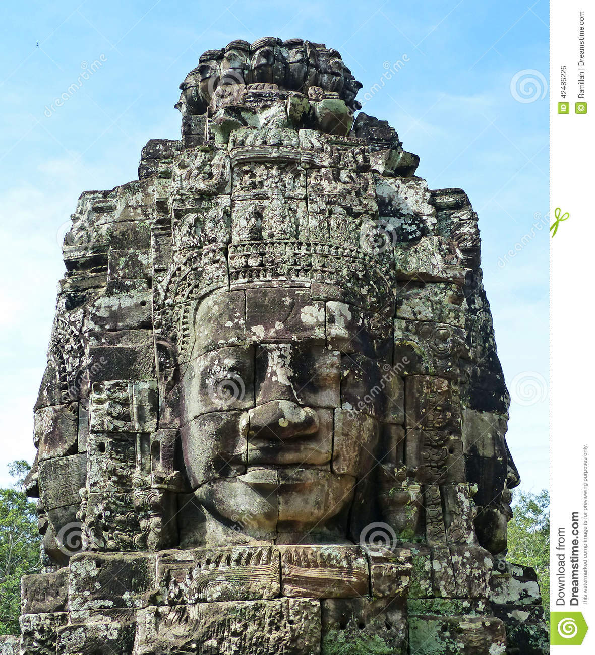 Ancient khmer stone carving of trimurti at bayon stock