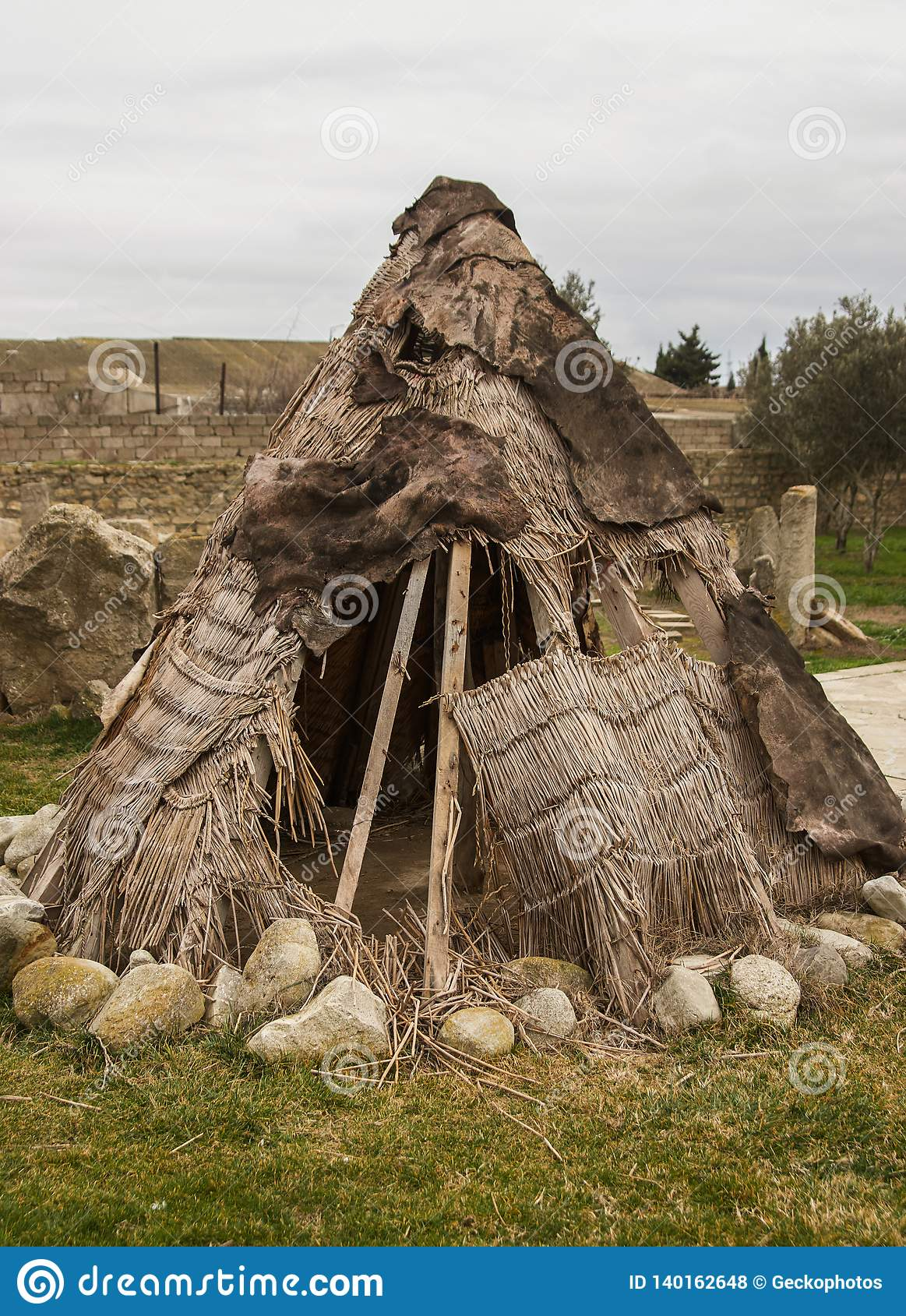 Ancient man hut. Teepee or wigwam tent house, outdoors